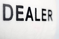 forefront of the word dealer on a white background