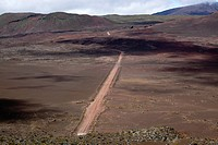 Dirt road on the Plaine des Sables plateau at the foot of the Piton de la Fournaise volcano, La Reunion island, Indian Ocean