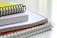Detail of notebooks on white background