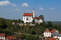 Burg Goessweinstein castle, 1076, remodelled in 1890 in the neo_Gothic, below houses of Goessweinstein, Upper Franconia, Bavaria, Germany, Europe