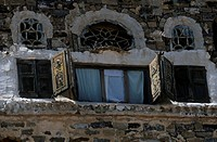Yemen - Sanaa Province - Thula, windows of a traditional house.