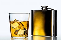 glass of whisky on the rocks and stainless flask on white background