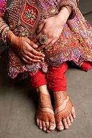 Close up of hand and foot mehndi