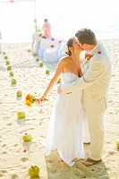 Bridal couple kissing on beach