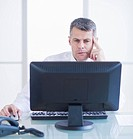 Portrait of businessman working at desk