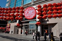 Asia, China, Beijing, red lanterns for the new year at the entrance of a mall                                                                         ...