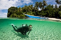 Scuba Diver in Lagoon of Ahe Island, Cenderawasih Bay, West Papua, Indonesia ...