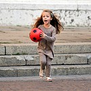 Little girl run with a red ball                                                                                                                       ...