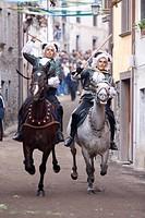 Italy, Sardinia, Santu Lussurgiu, traditional horse race on the town streets ...