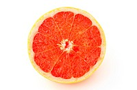 close_up of half grapefruit on white background