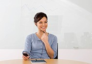 Portrait of smiling businesswoman using cell phone