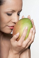 beautiful asian portrait isolated studio woman holding mango