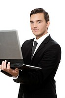 young business man standing and holding laptop on white