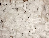 A background of white curls of polystyrene