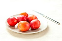 A plate of fresh plums