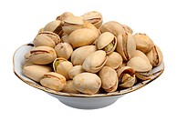 Pistachios on a plate on a white background, isolated