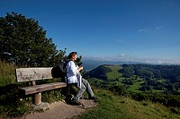 Woman sitting on a bench, Rhoen Mountains, Hesse, Germany, Europe