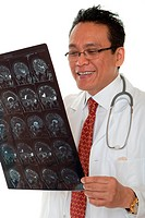Doctor diagnosis x_ray, asian man look at film against white background