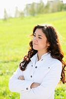 Young confident brunette in white casual clothes looking sideways