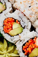 Vegetarian sushi California roll with rice and seaweed background
