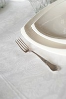 Silver fork with white plates on the table