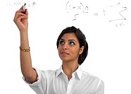 Young, beautiful teacher/businesswoman presenting/solving equations on a see_through screen