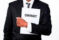 Close_up of an African businessman holding a contract isolated against white