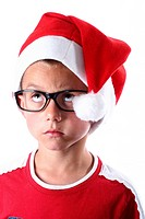 Young boy with santa hat and glasses