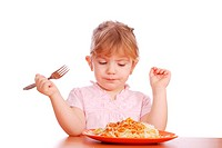 beauty little girl eat spaghetti
