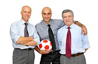 Businessmen with a soccer ball isolated in white