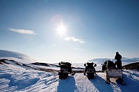 Three snowmobiles on a Svalbard Landscape _ winter adventure