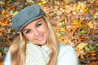 Portrait of happy beautiful young woman outdoors. Autumn environment.