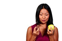 A woman trying to decide whether or not to eat healthy