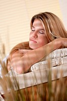Spa _ Young woman at wellness therapy treatment relaxing