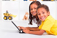 african american brother and sister playing laptop computer