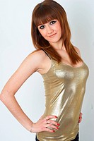 Beautiful redheaded girl posing in studio on white background