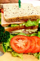 Delicious ham and salad sandwich with ingredients ready to serve.