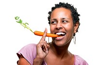 Beautiful african holding a fresh carrot instead of a cigarett