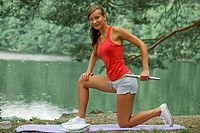 happy woman with dumbbell in natural outdoor setting