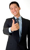 Smiling young business man of Asian giving you a thumbs up sign isolated against white.