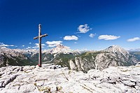 Cross on the summit of Monte Piano mountain, view, Hochpustertal valley, Dolomites, Croda Rossa mountain at the back, province of Bolzano-Bozen, Italy...