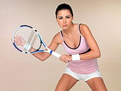 Beautiful female tennis player on natural background