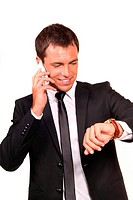 Portrait of a handsome young business man on cell phone
