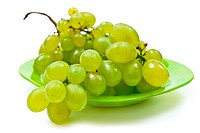 Green grape on plate isolated on white background