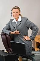 A beautiful Caucasian woman working in an office