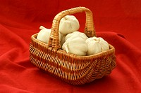 some fresh organic garlic in a basket