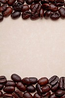 coffee beans on a parchment paper background