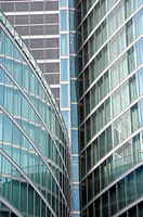 Modern building glass facades geometric lines and reflections