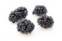 Close up of blackberries in isolated white background
