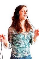 Pretty brunette girl listening music in headphones